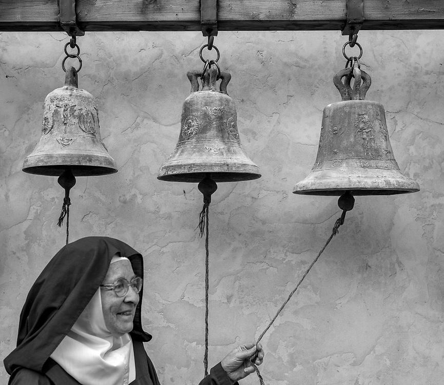 Mother Theresita rings the bells at the Carmelite Monastery in Carmel, Calif. on June 29, 2018.