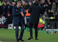 Football - 2018 / 2019 Premier League - West Ham United vs. Brighton & Hove Albion<br /> <br /> Chris Hughton, Manager of Brighton and Hove Albion, checks on his watch the time remaining as his side cling on <br /> at the London Stadium<br /> <br /> COLORSPORT/DANIEL BEARHAM
