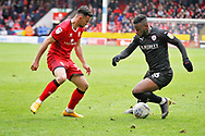 Barnsley forward Mamadou Thiam tries to take on Walsall FC midfielder Zeli Ismail (10) during the EFL Sky Bet League 1 match between Walsall and Barnsley at the Banks's Stadium, Walsall, England on 23 March 2019.