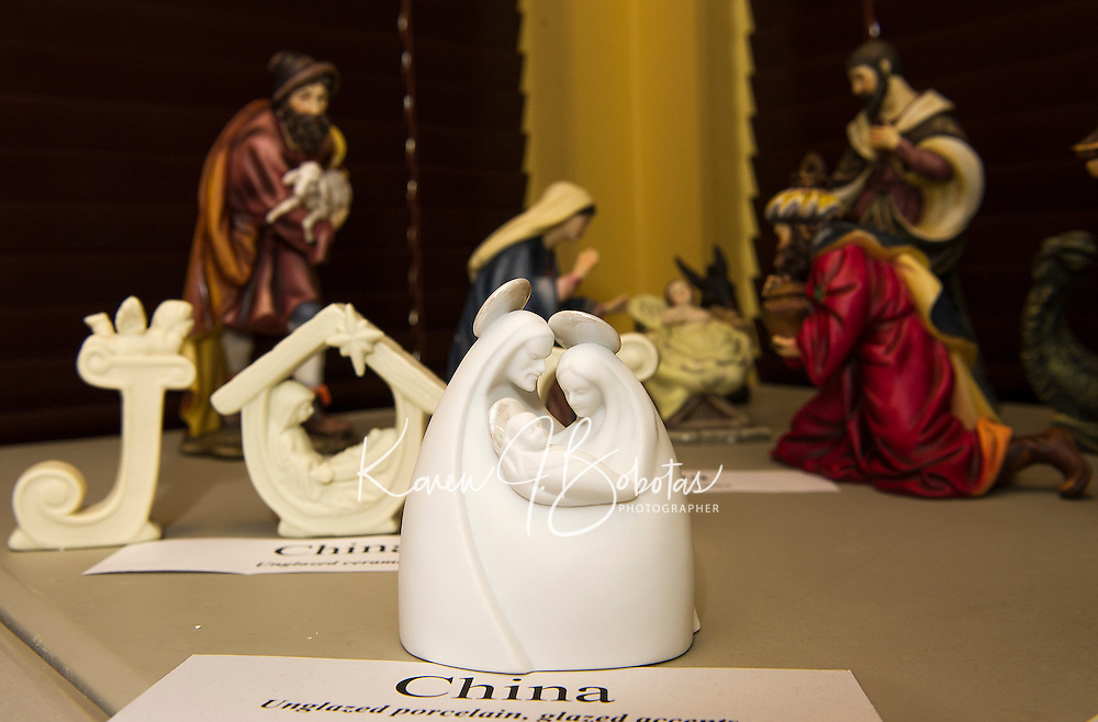 This porcelain nativity scene from China is one of Rev. John Eaton's 100 nativity scenes on display at the Meredith Bay Colony Club through Sunday.  (Karen Bobotas/for the Laconia Daily Sun)