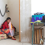 Cholita wrestler Yolanda La Amorosa tends to her broken lip after her bout during the 'Titans of the Ring' wrestling group's Sunday performance at El Alto's Multifunctional Centre. Bolivia. The wrestling group includes the fighting Cholitas, a group of Indigenous Female Lucha Libra wrestlers who fight the men as well as each other for just a few dollars appearance money. El Alto, Bolivia, 11th April 2010. Photo Tim Clayton