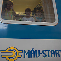 Illegal migrant children wait on their train to travel to Germany at the main railway station Keleti in Budapest, Hungary on August 31, 2015. ATTILA VOLGYI