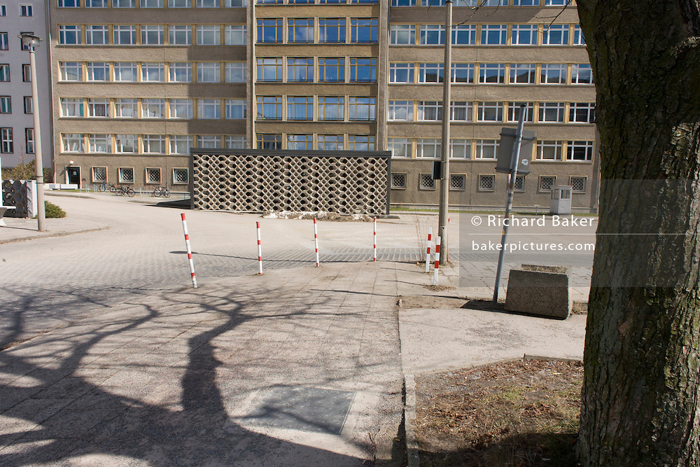 Forecourt of 'Haus 1' the ministerial headquarters of the Stasi secret police in Communist East Germany, the GDR. Built in 1960, the complex now known as the Stasi Museum. Before the fall of the Wall, it was a 22-hectare complex of espionage whose centrepiece is the office and working quarters of the former Minister of State Security, Erich Mielke who considered their role as the 'shield and sword of the party', conducting one of the world's most efficient spying operations against its political dissenters during its 40-year old socialist history. Between 1950 and 1989, the Stasi employed a total of 274,000 people in an effort to root out the class enemy. During Hitler's Third Reich, the Gestapo had one agent for every 2,000 citizens whereas the Stasi had approximately an spy for every 6.5. Here at the Stasi HQ alone 15,000 were employed plus the many regional stations. German media called East Germany 'the most perfected surveillance state of all time' - administered from this complex of offices.