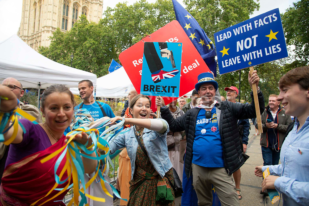 Steve Bray of pro remain campaign group Sodem dances with members of the Hare Krishna movement on the day after Parliament voted to take control of Parliamentary proceedings and prior to a vote on a bill to prevent the UK leaving the EU without a deal at the end of October, on 5th September 2019 in London, United Kingdom. Prime Minister Boris Johnson has insisted Britain will leave the European Union on October 31 2019, despite a defeat in the House of Commons at the hands of MPs from across political partys.