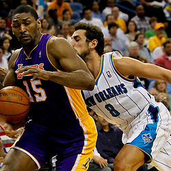 April 9, 2012; New Orleans, LA, USA; Los Angeles Lakers small forward Metta World Peace (15) has the ball knocked away by New Orleans Hornets shooting guard Marco Belinelli (8) during the second half of a game at the New Orleans Arena. The Lakers defeated the Hornets 93-91. Mandatory Credit: Derick E. Hingle-US PRESSWIRE