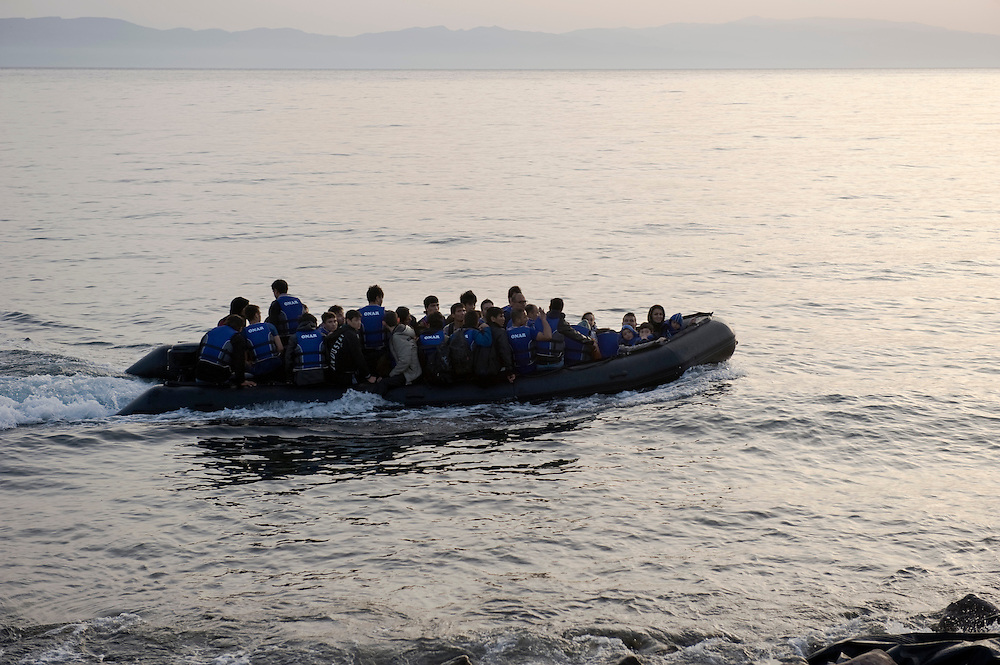 A small inflatable boat with more than 40 Afghan refugees,minutes before landing on the beach of Skala Sykaminias, Lesbos island, Greece. Everyday hundreds of refugees, mainly from Syria and Afghanistan, are crossing in small overcrowded inflatable boats the 6 mile channel from the Turkish coast to the island of Lesbos in Greece. Many spend their life savings, over $1000, to buy a space on those boats.