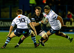 Peter Horne of Glasgow Warriors under pressure from Jarrod Evans of Cardiff Blues<br /> <br /> Photographer Simon King/Replay Images<br /> <br /> Guinness PRO14 Round 15 - Cardiff Blues v Glasgow Warriors - Saturday 16th February 2019 - Cardiff Arms Park - Cardiff<br /> <br /> World Copyright © Replay Images . All rights reserved. info@replayimages.co.uk - http://replayimages.co.uk