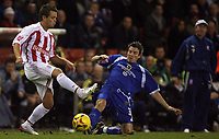 Photo: Paul Thomas.<br /> Stoke City v Cardiff City. Coca Cola Championship. 28/11/2006.<br /> <br /> Lee Hendrie (L) of Stoke is tackled by Kevin McNaughton.