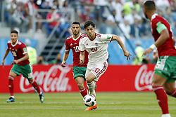 (l-r) Younes Belhanda of Morocco, Sardar Azmoun of IR Iran