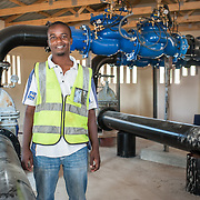 CAPTION: Loveridge stands in the pump control room of the almost complete Bindagombe Irrigation Scheme. LOCATION: Mawoneke Village, Chivi District, Masvingo Province, Zimbabwe. INDIVIDUAL(S) PHOTOGRAPHED: Loveridge Ngwena.