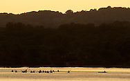 Cornwall-on-Hudson, New York - Kayakers on the Hudson River at sunset on June 15, 2011.