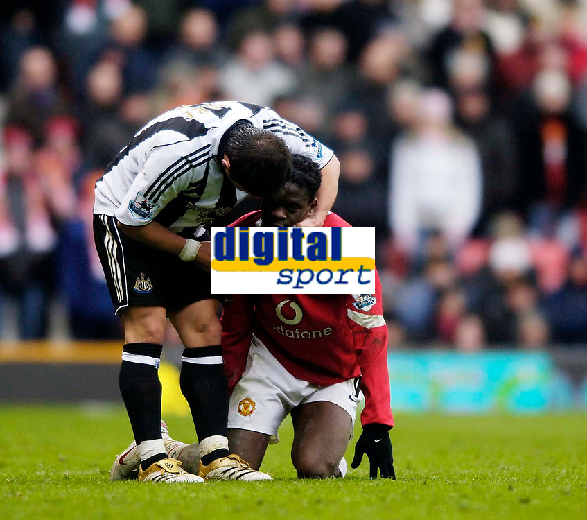 Photo: Jed Wee.<br /> Manchester United v Newcastle United. The Barclays Premiership. 12/03/2006.<br /> <br /> Newcastle's Emre (L) checks on the condition of Manchester United's Louis Saha after his foul on him.