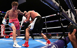 Lester Cantillano (right) and Archie Sharp in the International Super-Featherweight Contest at The O2, London