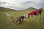 Cloth drying on a wooden cart. Mongolia.
