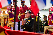 29 SEPTEMBER 2014 - NAKHON NAYOK, NAKHON NAYOK, THAILAND: General PRAYUTH CHAN-OCHA prays during the retirement ceremony for Prayuth and 200 other generals. Gen. Prayuth Chan-ocha led the 22 May coup against the civilian government earlier this year. Prayuth has been chief of the Thai army since 2010. After his retirement, Gen. Prayuth will retain his posts as head of the junta's National Council for Peace and Order (NCPO) and Prime Minister of Thailand. Under Thai law, military officers must retire at 60 years of age. The 200 generals who retired with Prayuth were also his classmates at the Chulalomklao Royal Military Academy in Nakhon Nayok.    PHOTO BY JACK KURTZ