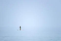 A paddle boarder at Fistral in Newquay, Cornwall.