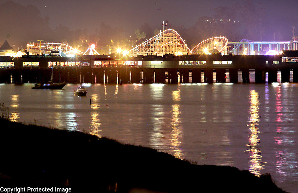The lights of the Municipal Wharf and the Boardwalk reflect on the Monterey Bay at Cowell Beach.<br /> Photo by Shmuel Thaler <br /> shmuel_thaler@yahoo.com www.shmuelthaler.com