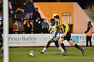 Colchester United's Kwame Poku (23) battles for possession with Jack Iredale (3) of Cambridge United during the EFL Sky Bet League 2 match between Cambridge United and Colchester United at the Cambs Glass Stadium, Cambridge, England on 15 December 2020.