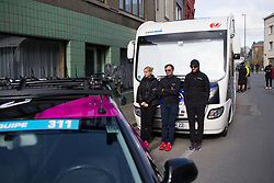 CANYON//SRAM Racing staff members are trying to saty wamthe Liege-Bastogne-Liege Femmes - a 135.5 km road race, between  Bastogne and Ans on April 23, 2017, in Liege, Belgium.