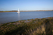 Sailing boat on River Deben, Suffolk, England