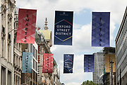 Banners along the shopping district of Oxford Street, on 26th May 2021 in London, United Kingdom. As the coronavirus lockdown continues its process of easing restrictions, more and more people are coming to the West End as more retail businesses open.