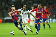 Harry Kane of Tottenham Hotspur runs past Aleksandr Golovin of CSKA Moscow and Bibras Natkho of CSKA Moscow. UEFA Champions league match, group E, Tottenham Hotspur v CSKA Moscow at Wembley Stadium in London on Wednesday 7th December 2016.<br /> pic by John Patrick Fletcher, Andrew Orchard sports photography.