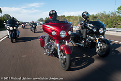 Motorcycle Racer Carey Hart riding a red 2017 Indian Chieftain Elite with Bagger Magazine's Morgan Gales (l) and AJ Smyth of Indian (r) riding 2017 Indian Chieftain Limiteds on I-95 during Daytona Beach Bike Week. FL, USA. Friday March 10, 2017. Photography ©2017 Michael Lichter.