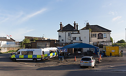 © Licensed to London News Pictures. 05/06/2017. LONDON, UK.  A general view of the Ship and Shovel pub in Dagenham this morning where police vans are seen at the rear. Police carried out a raid at a Dagenham address early this morning in connection with the London Bridge terror attacks and residents reported hearing gun shots.  Photo credit: Vickie Flores/LNP
