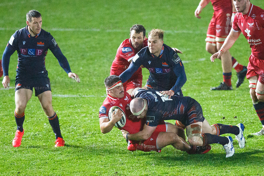 Llanelli, UK. 1 November, 2020.<br /> Scarlets replacement Dom Booth is tackled in the Scarlets v Edinburgh PRO14 Rugby Match.<br /> Credit: Gruffydd Thomas/Alamy Live News