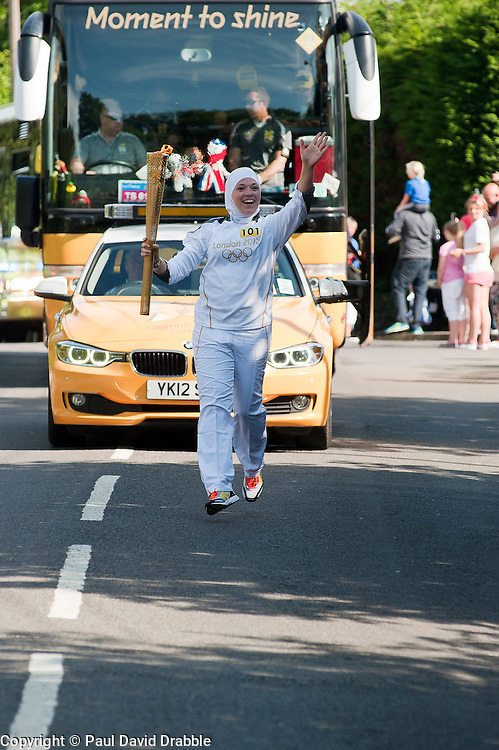 The Olympic Torch relay reaches Sheffield on day 38 coverage from the Chapeltown - Ecclesfield - Parson Cross section of the Journey.<br /> Runner 101 Dana Abdulkarim starts the chapeltown section of the run on Cowley Lane<br /> 25 June 2012.Image © Paul David Drabble