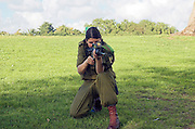 Female Israeli soldier aiming her rifle