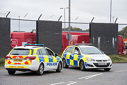 © Licensed to London News Pictures; 11/09/2020; Bristol, UK. Police at the Bristol Royal Mail sorting office in Filton. Emergency services are searching the Royal Mail sorting offices in both Bristol and Bath after a suspicious package was found during the night. Police think the package may have been sent from Bristol to the Bath sorting office in a lorry. Royal Mail staff have been told not to go into work. Today is the 19th anniversary of 9/11 terrorist attacks in New York. Photo credit: Simon Chapman/LNP.
