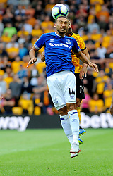 Cenk Tosun of Everton competes with Raul Jimenez of Wolverhampton Wanderers for the highball - Mandatory by-line: Nizaam Jones/JMP - 11/08/2018/ - FOOTBALL -Molineux  - Wolverhampton, England - Wolverhampton Wanderers v Everton - Premier League