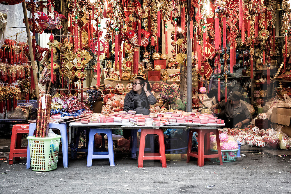 A vendor sells Tet decorations in a stall along Hang Ma Street in Hanoi's Old Quarter, Vietnam, Southeast Asia