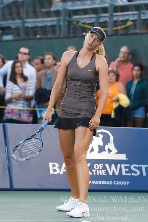 July 27, 2011; Stanford, CA, USA;  Maria Sharapova (RUS) reacts after a point against Daniela Hantuchova (SVK), not pictured,  during the second round of the Bank of the West Classic women's tennis tournament at the Taube Family Tennis Stadium.