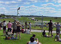 Horse Racing - Epsom Festival - Derby Day - Epsom Downs<br /> <br /> Race goers watch the first race of the day at Tattenham Corner behind the fences to stop the public entering the course<br /> <br /> Credit : COLORSPORT/ANDREW COWIE