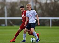 DERBY, ENGLAND - Friday, March 8, 2019: Derby County's Louie Sibley (R) is tackled by Liverpool's Alex Oxlade-Chamberlain (L) during the FA Premier League 2 Division 1 match between Derby County FC Under-23's and Liverpool FC Under-23's at the Derby County FC Training Centre. (Pic by David Rawcliffe/Propaganda)
