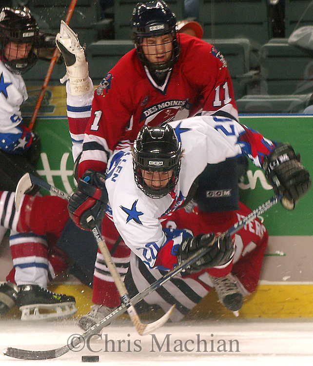 CM- 11/11/03 Council Bluffs, IA River City Lancer Michael Mullen gets knocked down by the  Des Moines Buccaneers' Travis Anderson Tuesday night at the Mid America Center...(photo by Chris Machian/fPrairie Pixel Group)