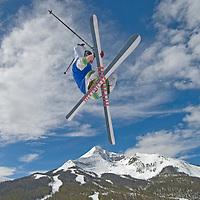 SKIING. Ben Wiltsie (MR) skis aerial manouvers and flips in half pipe in terrain park at Big Sky Ski Resort, near Bozeman, Montana.