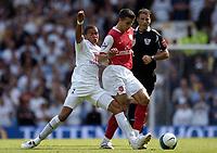 Photo: Olly Greenwood.<br />Tottenham Hotspur v Arsenal. The FA Barclays Premiership. 15/09/2007. Jermaine Jenas tackles Robin Van Persie