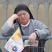 ASSISI, ITALY - OCTOBER 04:  A nun waits for Pope Francis on October 4, 2013 in Assisi, Italy.  Pope Francis is due to venerate the tomb of San Francesco of Assisi at the crypt of the Upper Basilica of Saint Francis tomorrow during his one-day visit to the city.  (Photo by Marco Secchi/Getty Images)