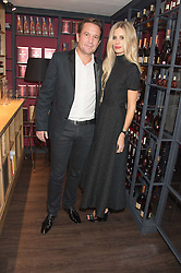 ERIC VALLAT CEO of Remy Martin and LAURA BAILEY at the launch of La Maison Remy Martin pop-up private members club at 19 Greek Street, Soho, London on 2nd November 2015.