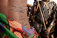 A Jie warrior with AK-47 scarification marks in Jonglei state, Southern Sudan.