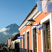 Volcán de Agua in the distance, with the colonial architecture of Antigua, Guatemla in the foreground.