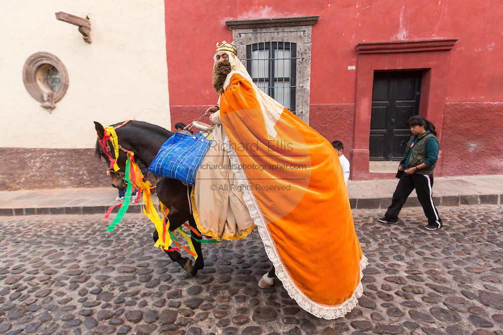 The Three Kings ride by horseback through the cobble streets handing out candy to children during El Dia de Reyes January 6, 2016 in San Miguel de Allende, Mexico. The traditional festival marks the culmination of the twelve days of Christmas and commemorates the three wise men who traveled from afar, bearing gifts for the infant baby Jesus.