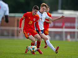 NEWPORT, WALES - Friday, September 3, 2021: Wales' Joel Cotterill (L) and England's Brodi Hughes during an International Friendly Challenge match between Wales Under-18's and England Under-18's at Spytty Park. (Pic by David Rawcliffe/Propaganda)