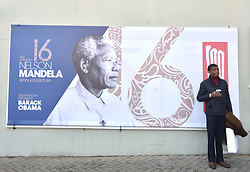 A man is seen standing next to Nelson Mandela poster at the Bidvest Wanderers Stadium were former US president Barack Obama is expected to deliver the annual Nelson Mandela lecture, Gauteng.<br />Picture: Itumeleng English/African News Agency (ANA)