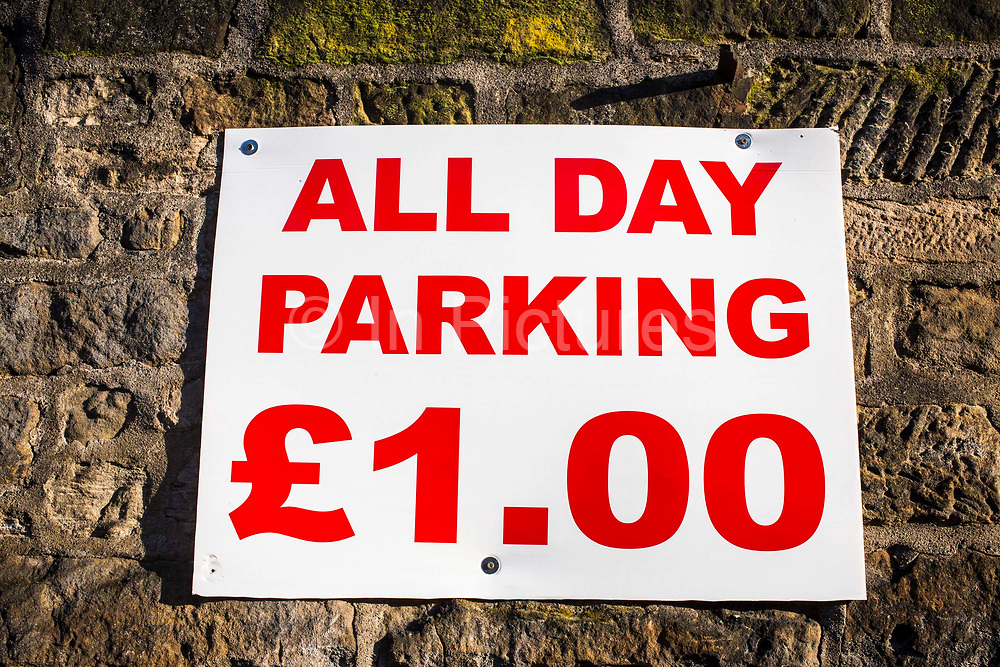 All day parking £1 sign in Middlesborough town centre, North Yorkshire, United Kingdom.