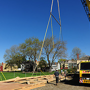 Hoisting begins very slowly to make sure nothing happens to the 6800 pound wall as it is raised.