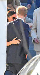 *** PREMIUM EXCLUSIVE *** Lovebirds Prince Harry and Meghan Markle walked down the aisle on Friday - but only as guests at the Jamaican wedding of one of the Prince's closest friends. And after the ceremony, they were seen to tenderly embrace, with Meghan wrapping her arm around love-struck Harry. Wearing a navy blue suit and yellow corsage, Harry looked every bit the handsome Prince as he undertook his official usher duties at the ceremony at the Hopewell Baptist Church in Montego Bay. Meghan made the most of the Caribbean sunshine, sporting a flowery dress and sunglasses as she accompanied her beau at the wedding of Tom 'Skippy' Inskip and flame-haired literary agent, the Hon Laura Hughes-Young. Earlier in the day, Harry, 32, was seen on the beach in lime green board shorts, while Meghan wore a tiny turquoise bikini. The pair happily kissed and cuddled in front of pals before frolicking in the sea. Later 35-year-old Meghan enjoyed a glass of wine while Harry smoked cigarettes and chatted to his mates. The fifth in line to the throne flew out from Gatwick to Montego Bay on Wednesday and is staying at one of the most luxurious resorts on the coast. the super exclusive Round Hill Hotel and Villas, a private 110-acre plantation style resort first built as a colony of cottages for the rich, famous and glamorous of the 1950s. It boasts £1,600-a-night shore-side pool villas, one of which is believed to have been snapped up by Harry and Miss Markle, which are decorated in cool, Caribbean shades, with open-air living spaces, outdoor showers and locally handcrafted furniture. Elsewhere the resort's £500-a-night hotel suites are designed by Ralph Lauren, while facilities include a top-class spa, tennis courts and infinity pool, all nestled in carefully-tended tropical gardens. The Prince and divorced Meghan, who stars in the hit US legal drama series Suits, have been dating since last summer and despite living on different continents, the relationship has quickly tak